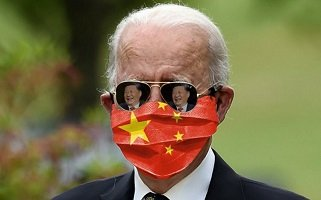 This image has an empty alt attribute; its file name is biden-communist-buffoon.jpg